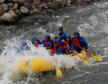 A group of whitewater rafters on a Colorado river